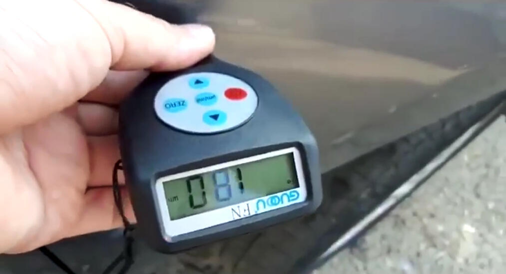 measuring the paint thickness on the car
